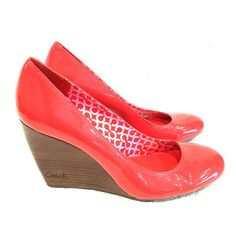 """Coach Wedge Pumps These beautiful coral patent leather pumps have approximately a 4"""" wedge heel and an almond toe. They're extremely comfortable with lightly cushioned soles. Pre-loved condition with some imperfections on the leather (can post additional pics upon request). Doesn't come with original box. Coach Shoes"""