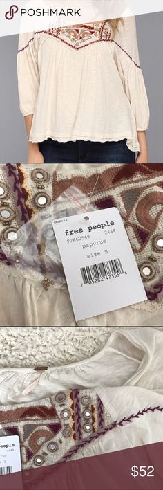 Free People Santa Fe dolman blouse Super cute NWT dolman blouse from Free People. With embroidered and beaded detail. Size small. Fits more like a medium since it's oversized. 100% cotton. Trim is 75% cotton, 25% nylon. Off white. Free People Tops Blouses