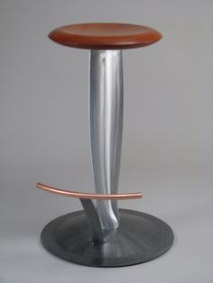 Propeller Stool by Arnt Arntzen. A bar stool crafted from an airplane propeller blade, with a circular seat in solid Mahogany and a copper foot rest.  Available at Kozai Modern $1,950