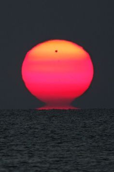 This dramatic telephoto view across the Black Sea on June 6 finds Venus rising with the Sun, the planet in silhouette against a ruddy and ragged solar disk. Of course, the reddened light is due to scattering in planet Earth's atmosphere and the rare transit of Venus didn't influence the strangely shaped and distorted Sun. (Photo: Emil Ivanov via NASA APOD)