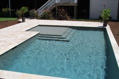 This swimming pool shape is a beautiful geometric swimming pool was built by Aqua Blue Pools. Notice that the fist step in the swimming pool is over-sized. Small Backyard Pools, Backyard Pool Designs, Small Pools, Swimming Pools Backyard, Swimming Pool Designs, Pool Landscaping, Blue Pool, Pool Steps Inground, Beach Entry Pool