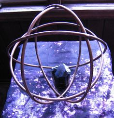 """Here's a 12"""" Genesa Crystal I made with copper tubing 16 years ago. I put a large black tourmaline crystal inside of it."""