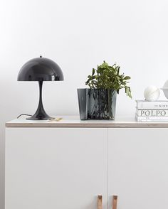 The beautiful Aalto Vase from @iittala in the new dark grey color holding a subtile bunch of mistletoe