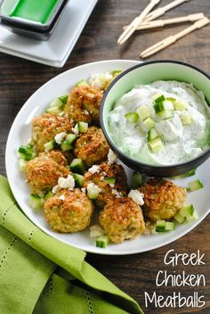Greek Chicken Meatballs with Herbed Yogurt Sauce - a light and healthy dinner, or a party bite that can be kept warm in a slow cooker!