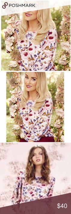 """LC Lauren Conrad Floral Bow Sleeve Blouse NWT Showcase your femininity with this women's LC Lauren Conrad Floral Crepe top. Draped sleeves with bow cuffs give you charming style you'll love to wear.  MEASUREMENTS (approx.)  ◦ Chest 42"""" Length 25""""  PRODUCT FEATURES ◦Crewneck with button-back closure ◦3/4-length sleeves ◦Lightweight crepe construction  FABRIC & CARE ◦Polyester ◦Machine wash LC Lauren Conrad Tops Blouses"""