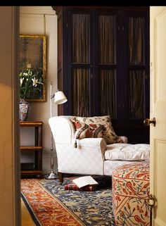 Wonderful chaise, gorgeous rug, ottoman, art, all of it (Robert Kime)