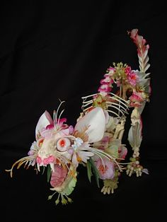 Super creepy (but also really cool) flower and skeleton art
