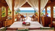 Necker Island-hut-bedroom-king-bed-ocean-view