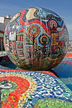 A colorful fountain with mosaic decorations, at the Sun Hill Condominium Complex (Kodra e Diellit), Tirana, Albania. Kodra e Diellit Residence is just a 5-minute drive from the center of town and a few steps from Tirana Lake Park and the Botanical Garden. Photo by Agi Kons Art (V)