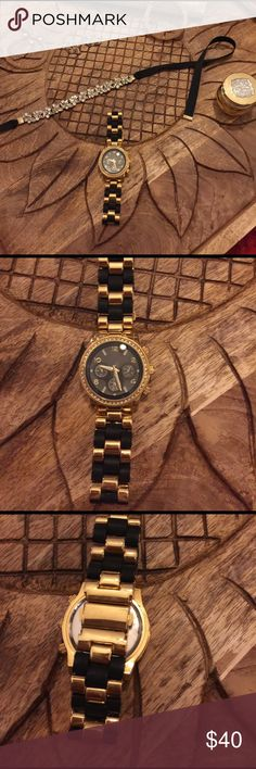 Beautiful Black & Gold Fashion Watch Beautiful Black & Gold Fashion Watch. Excellent Condition! None Jewelry