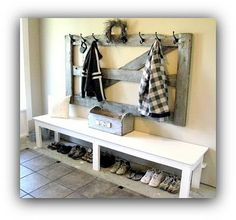 I am falling for the refurburished vintage look more and more!  Love the barn wood coat rack !