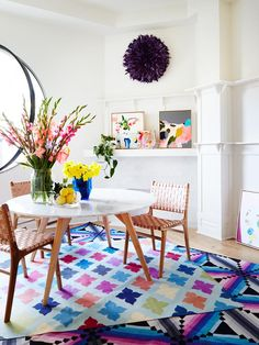 Purple JuJu hat, why not?! This space gives brave styling a whole new meaning. Layered vibrant rugs, a shelfie of Australian art and mix matched furniture all work a treat. See more by clicking through >>