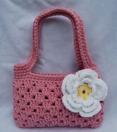 Boutique bags inspired by spring. I think the strappy pink one is my new favorite. What do you think? I decided to try out a bulkier yarn th...