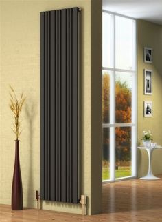 """The sleek design of the Reina Bonera Vertical designer radiator looks perfect in classic and modern homes alike. Wall Radiators, Bathroom Radiators, Vertical Radiators, Column Radiators, Kitchen Radiators, Contemporary Radiators, Designer Radiator, Family Room, New Homes"