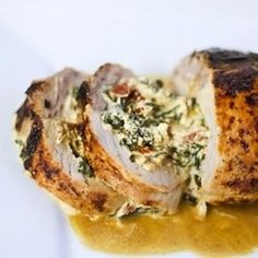 Pork tenderloin stuffed with spinach, sun-dried tomatoes, and a creamy goat cheese filling.