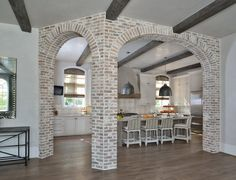 Sugar Land, TX Kitchen With Exposed Brick Arches by Cindy Witmer Designs Brick Arch, Luxe Interiors, House, Brick Archway, Exposed Brick, New Homes, Brick, Archways In Homes, Brick Interior