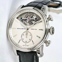Arnold and Son EC1 tourbillon with a column-wheel chronograph in a palladium case with a frosted silver dial.
