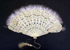 A dreamy fan from 1860-1870. Made with silk, ivory, and feather