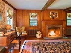 You can't really go wrong with adding a cozy rug and wood panelling to a fireplace. It's classic for a reason.