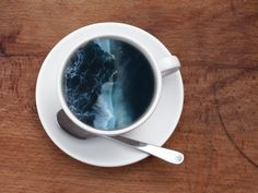 """Victoria Siemer is a Brooklyn-based graphic designer. In her project named """"Coffee Cup Manipulations"""", she adds amazing digital illustrations in coffee cups, representing waves, over-active ocean and galaxies. This technique adds a surrealism dose to a daily action."""
