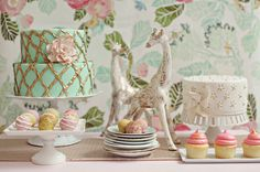 """WEDDING CAKE TABLE IDEAS: I love how they dressed up the cake table! It looks like they took a piece of wallpaper that matches all the colors, maybe made a tapestry out of it and hung it behind the table. The giraffes are a cute touch too -- My PDF """"663 Must-Have Wedding Ideas"""" has amazing ideas for your wedding at www.etsy.com/shop/OliverINK"""