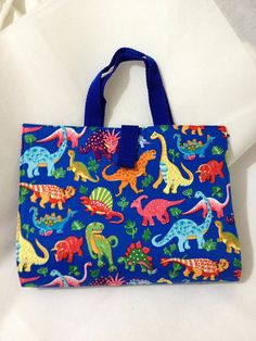 Activity Carry Busy Bag in blue Dinosaur Fabric with 5 ziplock