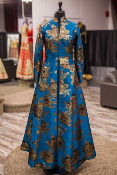 """The beauty of roses speaks to the heart"" This beautiful rose patterned Italian brocade jacket lacha definitely pulls on the heartstrings! We love the way the gold roses stand out on this stunning blue! Indian Gowns, Indian Attire, Indian Outfits, African Fashion Dresses, African Dress, Indian Fashion, Kurta Designs, Brocade Dresses, Anarkali Dress"
