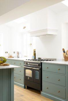 Green cabinets in a white kitchen @modernkitchen
