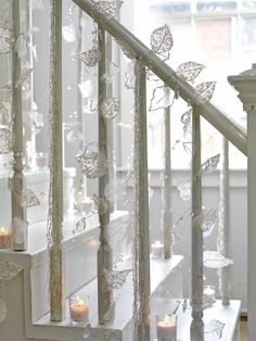 Hmmm... if I had a staircase, I would hang snow flakes off it... kind of like this....