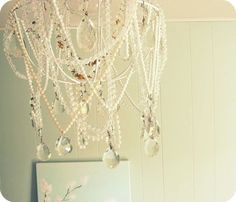 23. Someone made a crazy chandelier out of broken necklaces.