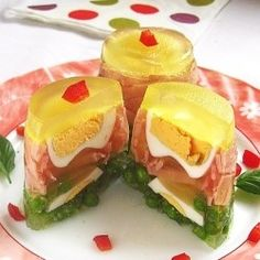 Aspic with vegetables, ham and egg.  Looks like a lot of work for something so disgusting.  What a waste of time.