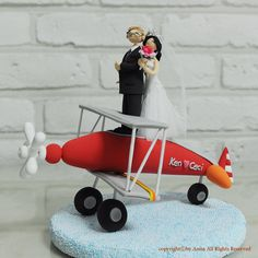 Cute couple on the red plane custom wedding cake by annacrafts, $280.00