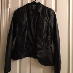 Wet Seal blazer Black faux leather blazer is super cute and has never been worn! Shell 1: 100% polyurethane with 100% rayon backing  Shell 2: 65% rayon 31% polyester 4% spandex  Lining: 100% polyester  Wet Seal - Junior small Wet Seal Jackets & Coats Blazers