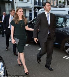 Chelsea Clinton arrives at Spencer House on the arm of husband Marc Mezvinsky for the wedding of Nicky Hilton