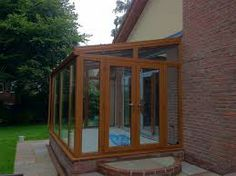 Image result for lean to conservatory brown upvc