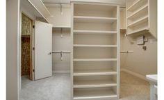 Walk-in master closet. Love the piece in the center