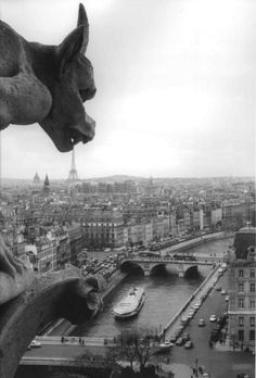 Paris // Photo by Robert Doisneau    I think the gargoyle is using the tower as a toothpick.