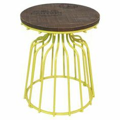 """Bring artful appeal to your living room or den with this charming accent table, featuring a yellow openwork base and typographic top.   Product: Accent tableConstruction Material: Metal and woodColor: Yellow and naturalDimensions: 20.25"""" H x 16"""" Diameter"""