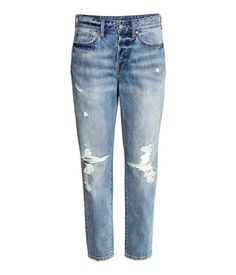 Denim blue. 5-pocket ankle-length jeans in washed denim with hard-worn details in a loose fit with a high waist, low crotch, button fly and straight legs