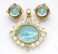 Elizabeth Locke--Venetian glass over mother-of-pearl set in 19K gold with pearls. Love her jewelry