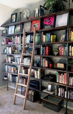 Bookcases-Bookcases-Bookcases-DIY Industrial Shelves on a Budget Think outside the box when it comes to updating spaces in your home that sit empty or get little attention. These large floor-to-ceiling shelves provide great storage as well as decor. Pipe Bookshelf, Floor To Ceiling Bookshelves, Pipe Shelves, Black Bookshelf, Large Shelves, Bookcases, Industrial Shelving, Industrial House, Open Shelving
