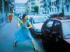 Pipilotti Rist, Ever Is Over All ,   1997, audio-video installation by Pipilotti Rist (video still)