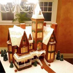 """2010 Gingerbread House Contest  Grand Winner: Victorian Christmas by Eduardo M., Omaha, NE    """"This gingerbread house stands four feet tall. 40 pounds of gingerbread and 30 pounds of royal icing are used. I guess you could call it a labor of love.""""    Eduardo M.  Omaha, NE"""