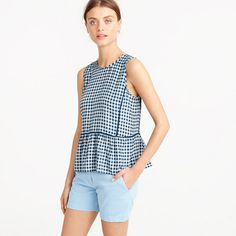 "A pretty silk top that's light as air with a ruffle hem, flattering contrast piping and one of our favorite prints of the summer, gingham. <ul><li>Body length: 24"".</li><li>Silk.</li><li>Dry clean.</li><li>Import.</li></ul>"