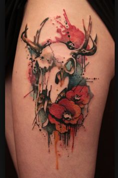 Very cool poppy and skull tattoo