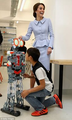 Kate collapses into giggles as she is introduced to a robot by a local youngster atBouwkeet for teenagers