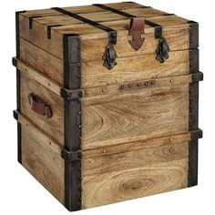 """Nothing says """"treasure"""" like a trunk, but you won't need a map to find our Pyra Trunk. Handsomely built of mango wood and reinforced with metal hardware, it has plenty of room for storing your favorite things. And when it's closed, it makes an interesting accent table."""