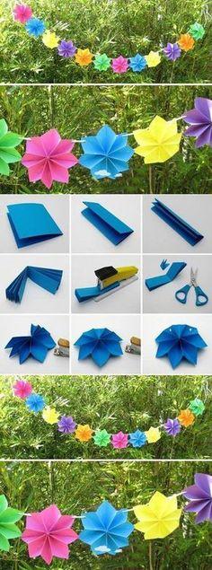 Tutorial para hacer esta bonita guirnalda de papel. Los materiales que necesitamos son pepel, grapadora, tijera y cuerda.