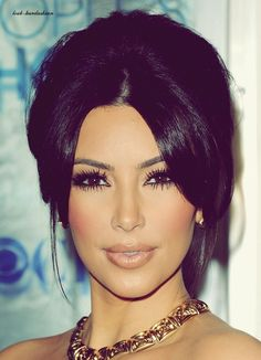 Kim's makeup. I love Kim she's a badass bitch, but she needs to lose that gorse discussing mean inhuman loser she's with! Ya, that's you Mr. West!