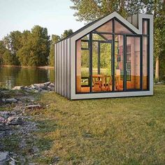 The smart flat-pack structures of The Bunkie Co in Garden Room Ideas. Additions such as folding chairs, a fireplace and cabinets are available.